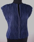 Crimp cloth©. Polyester warp; cotton weft. Zippered closure.